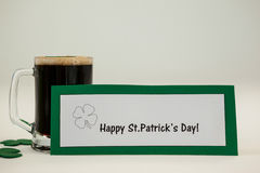 Mug of black beer and shamrock for St Patricks Day Stock Images