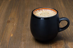 Mug of black coffee with foam and space for text Royalty Free Stock Photography