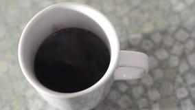 Mug of black coffee stock video