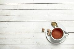 Mug with black tea. On a white wooden table stock images