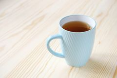Mug of black tea on a wooden table close-up stock images