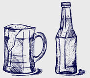 Mug and bottle beer Stock Image