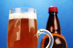 Mug and a bottle of beer. Stock Images