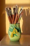 Mug with brushes Royalty Free Stock Photos