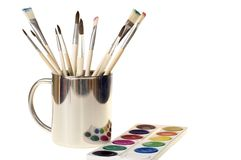 Mug brushes and paint Royalty Free Stock Photos