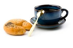 Mug and bun Royalty Free Stock Image