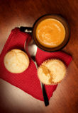 Mug of butternut bisque and corn muffins Stock Image