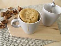 Mug cake with walnuts Stock Photos