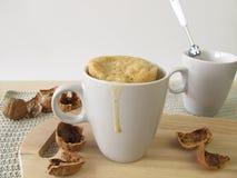 Mug cake with walnuts Royalty Free Stock Photography