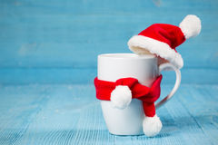 Mug in a cap and scarf Stock Image