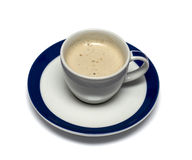 Mug from a cappuccino on a saucer with a blue border Stock Image
