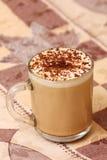 Mug of capuccino on table Stock Photo