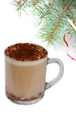 Mug of capuccino under fir-tree branch on white Stock Images