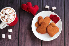 Mug of chocolate with heart gingerbread cookies Royalty Free Stock Photography