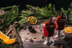 Mug of christmas mulled wine with spices and orange slices on rustic table stock photography