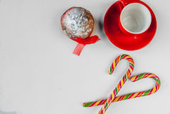 A mug for cocoa, cake and Christmas candy canes Stock Photography