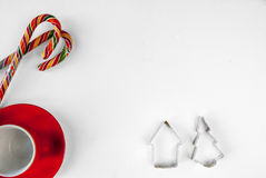 A mug for cocoa, cookie cutters and Christmas candy canes Royalty Free Stock Image