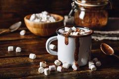 Mug of Cocoa with Marshmallows. Metal Mug of Cocoa with Marshmallows. Jar of Cocoa Powder and Marshmallow Bowl on Backdrop Stock Photography