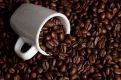 Mug of coffee. A Mug full with coffee beans Royalty Free Stock Images