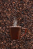 Mug of Coffee on Bean Background Royalty Free Stock Photo