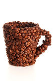 Mug in the coffee beans. Mug glued with coffee beans isolated on white background Stock Photos