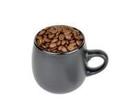 Mug with coffee beans Royalty Free Stock Photos