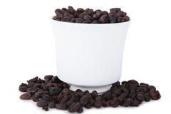 Mug of coffee beans Stock Photography