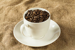 Mug with coffee beans Royalty Free Stock Photo