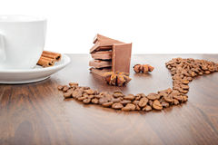 Mug, coffee beans, chocolate and anise Stock Images