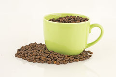 Mug with coffee beans Royalty Free Stock Image