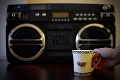 Mug of coffee, and best music player Royalty Free Stock Image
