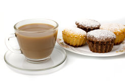 Mug of coffee and cupcakes Stock Photos