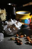 Coffee and oriental sweets. A mug of coffee and different oriental sweets: turkish delight, halva, almond and pistachio royalty free stock images