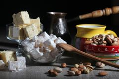 Coffee and oriental sweets. A mug of coffee and different oriental sweets: turkish delight, halva, almond and pistachio stock photography