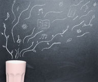 Mug of coffee with drawing steam on the blackboard from the top Stock Image
