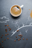 Mug of coffee with frothy and happy drawing on the blackboard Royalty Free Stock Photography