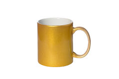 Mug for coffee gold colour. On a white isolated background Royalty Free Stock Photos