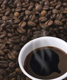 Mug of coffee and grain Stock Photo
