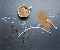 Mug of coffee with happy drawing on the blackboard from the top Stock Images
