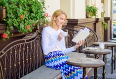 Mug coffee and interesting book best combination perfect weekend. Woman have drink cafe terrace outdoors. Reading is her. Hobby. Girl drink coffee while read royalty free stock photos