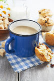 Mug coffee with milk and muffins Royalty Free Stock Images