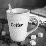 Mug of coffee on the old boards, black-and-white image Stock Photos