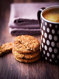 Mug of coffee and rustic cookies with nuts Royalty Free Stock Images