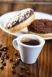 Mug coffee with sugar glazed donuts Royalty Free Stock Images