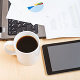 Mug of coffee and tablet pc on office table Stock Images