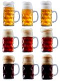 Mug collection of frosty beer with foam Royalty Free Stock Image