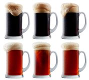 Mug collection of frosty beer with foam Royalty Free Stock Photos
