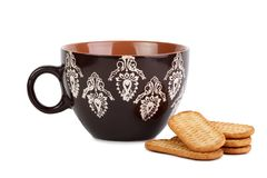 Mug with cookies on isolated white background royalty free stock images