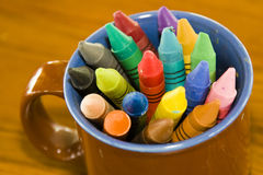 Mug of crayons. A mug of colorful crayons stock photography
