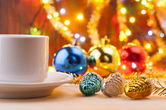 Mug with a cup in the New Year's table. Christmas still life. New Year's toys on the table. Stock Image